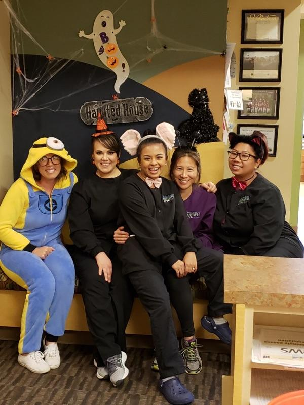 Staff at Children's Dentistry of DuPont, DuPont, WA dressed up in costumes for halloween.