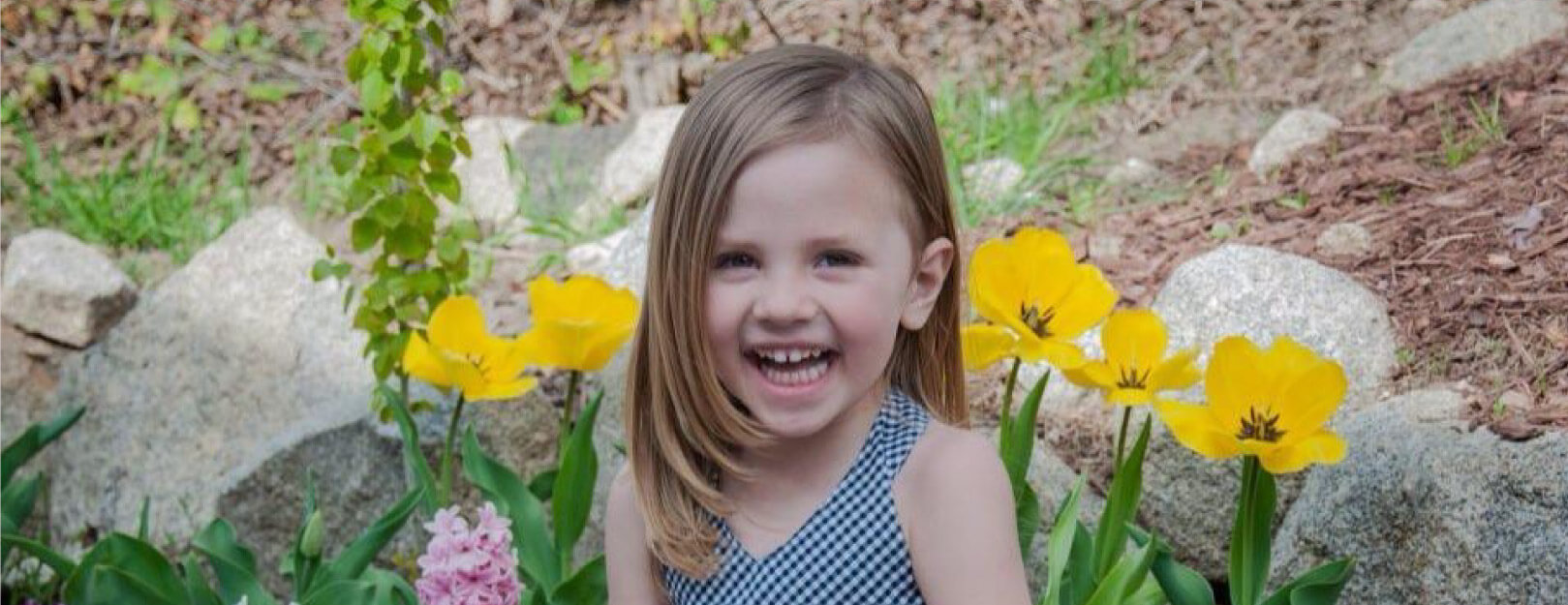 Picture of little girl smiling with flowers